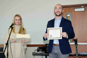 Cody Copelandis awarded First Place in his Poster Group at the Social Science Student Symposium (November 10, 2018)by Assistant Dean of the School of Sciences, Dr. Billi Patzius.