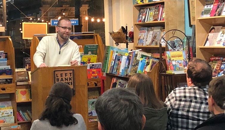Dr. Ben Cooper, Assistant Professor of English, speaks about his book, Veteran Americans: Literature and Citizenship from Revolution to Reconstruction, before an engaged crowd at Left Bank Books.