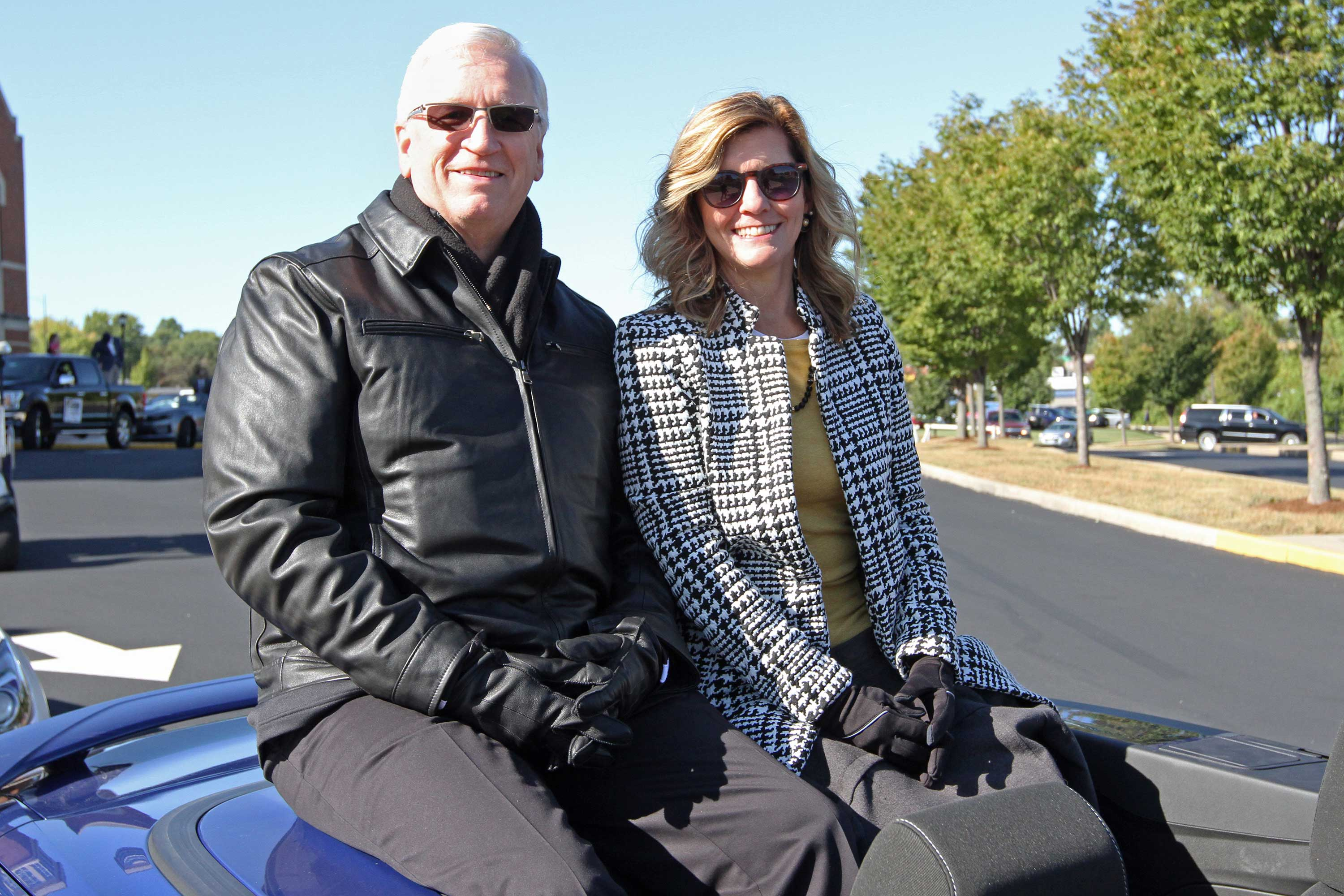 President Porter and Beverly in the Homecoming Parade
